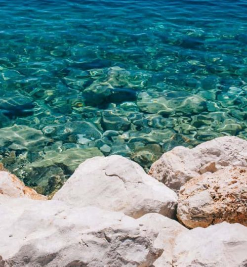 Rocky coastline with crystal clear blue Adriatic sea